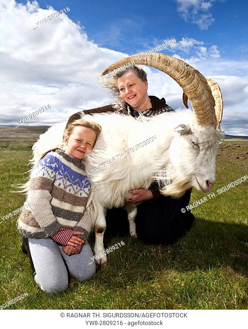 Mother and daugter with a goat, Goat farm, Western Iceland