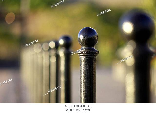 row of black metal posts in the main square in puerto de santiago heading away from camera Tenerife Canary Islands Spain