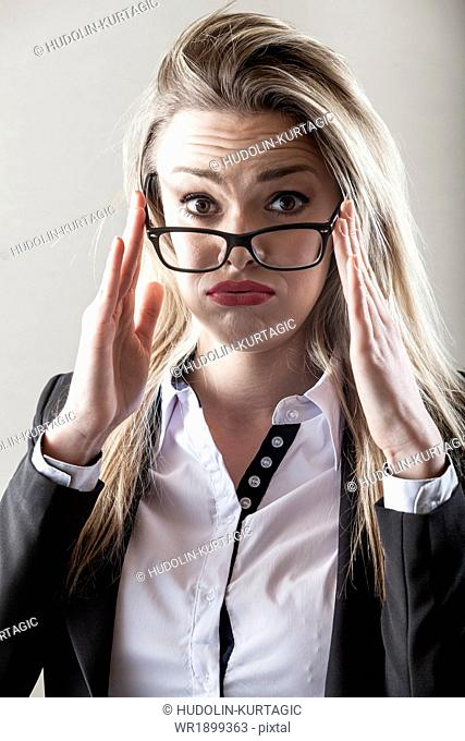 Businesswoman with eyeglasses frowning