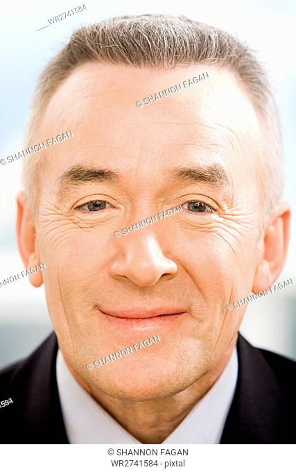 Headshot of a mature businessman