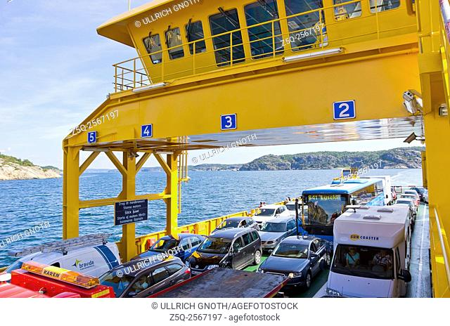 Cars and trucks being transported by ferry between skerries near Lysekil, Bohuslan, Sweden