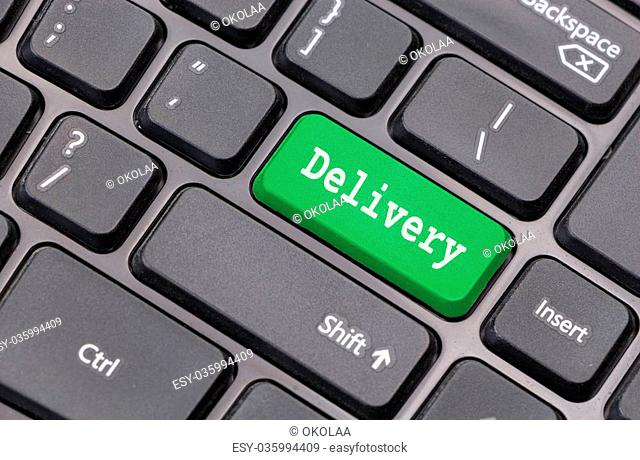 """Computer keyboard closeup with """"""""Delivery"""""""" text on green enter key"""