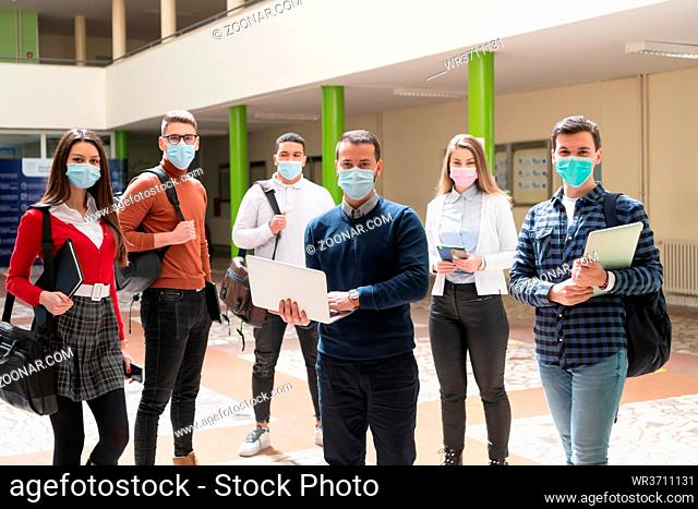 Multiethnic students group wearing protective face mask at university hallway new normal coronavirus time education concept