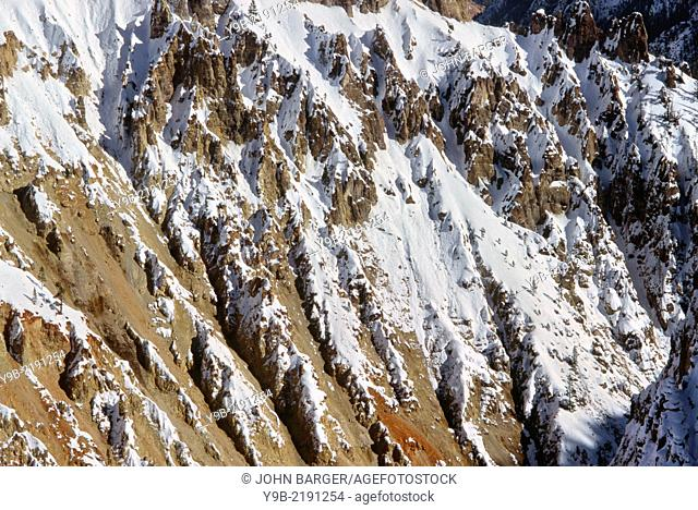 Winter snow on steep rhyolite cliffs, Grand Canyon of the Yellowstone, Yellowstone National Park, Wyoming, USA
