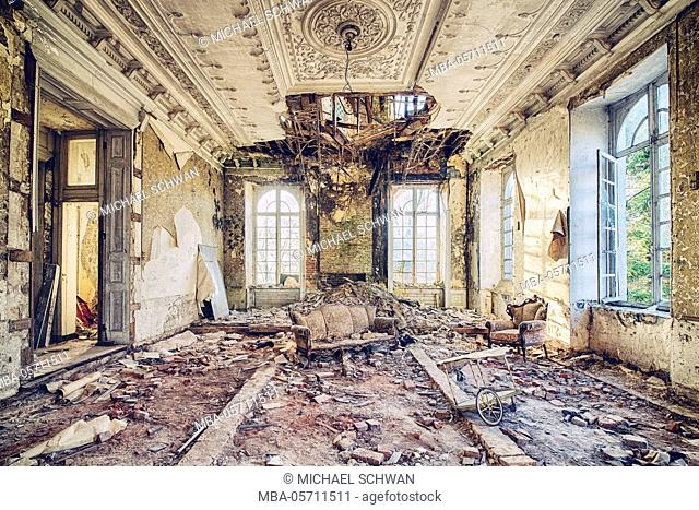 living area of a derelict castle with sofa