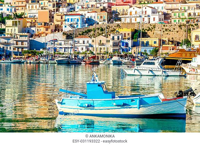 Small wooden colorful fishermen's boat in cosy Greek Port, Greece
