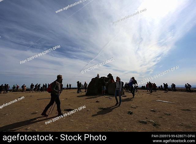 19 September 2020, Saxony-Anhalt, Schierke: Visitors hike on the Brockenstraße in the Harz Mountains. The sunny weather attracted numerous visitors to the...