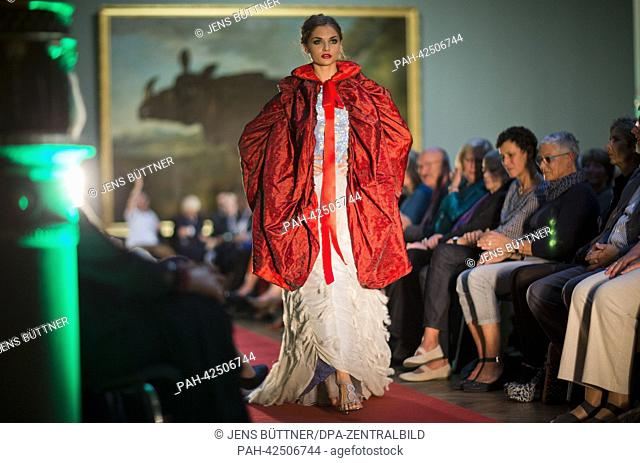 Models present the newest creations by fashion designer Andrej Subarew in front of the painting 'Rhinozeros Clara' by Jean Baptiste Oudry in the Oudry Hall at...