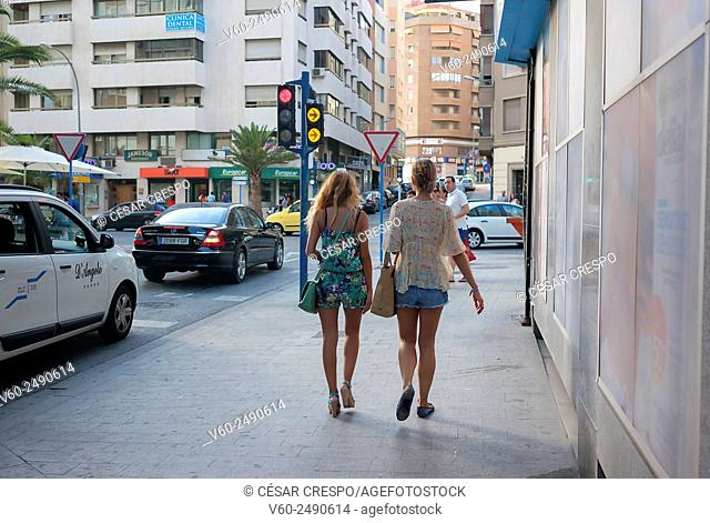 -Women chatting and walking- Alicante (Spain)