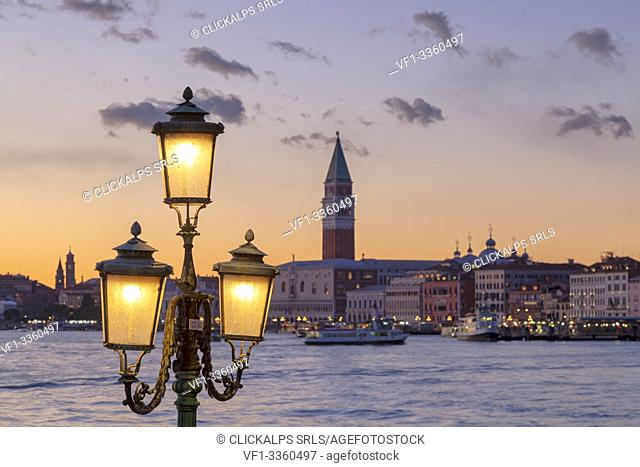 St. Mark's Campanile and Doge's Palace at sunset from Riva San Biasio at dusk, Venice, Veneto, Italy