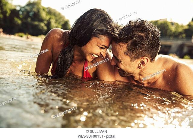 Happy couple bathing in river