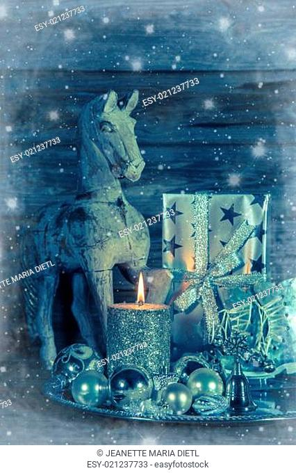 Shabby chic christmas decoration in silver with wooden horse, candle and present