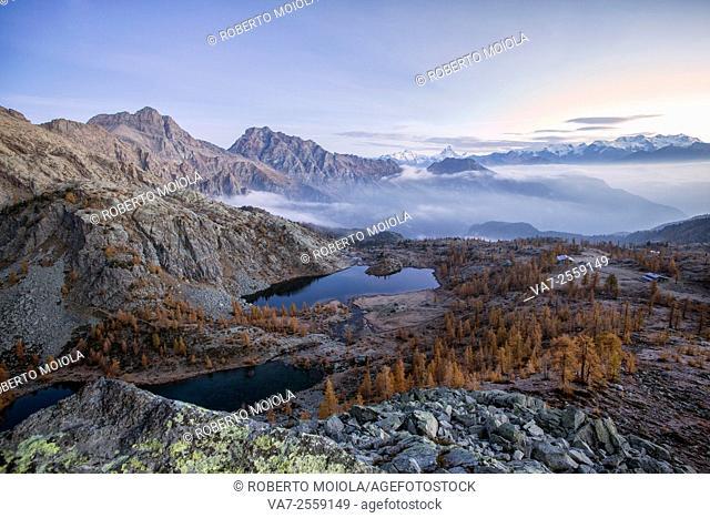 Sunrise on Matterhorn and Mount Rosa. Natural Park of Mont Avic. Valle d'Aosta Graian Alps Italy Europe