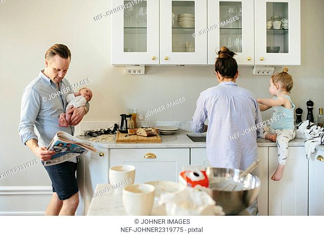 Family in kitchen