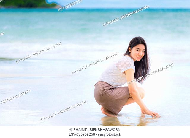 Beautiful Asian woman vacation on beach of Thailand