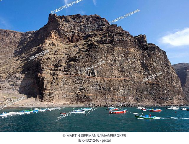 Fishing harbour in Vueltas with Tequergenche mountain, Valle Gran Rey, La Gomera, Canary Islands, Spain