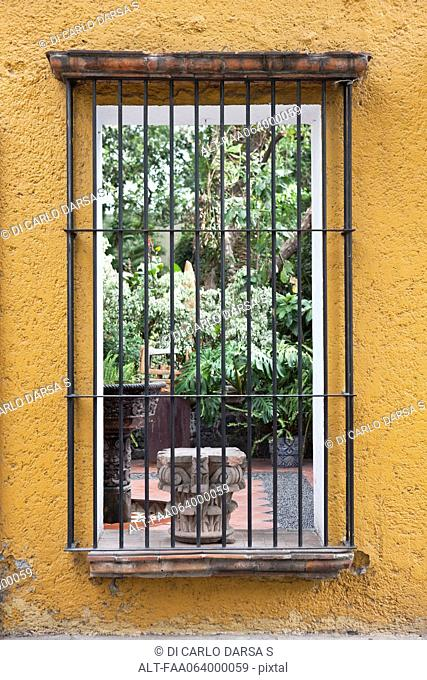 Barred window looking into courtyard