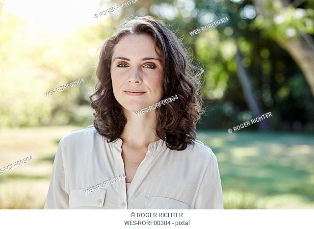 Portrait of confident young woman in park