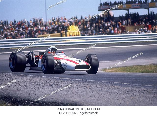 John Surtees driving a Honda, Spanish Grand Prix, Jarama, 1968. He failed to finish the race, retiring after 74 laps with a gear linkage problem