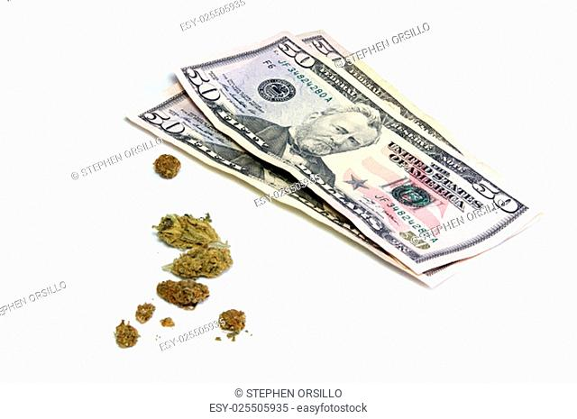 A stack of three 50 dollar US bills is shown behind a cluster of marijuana pot buds, over white