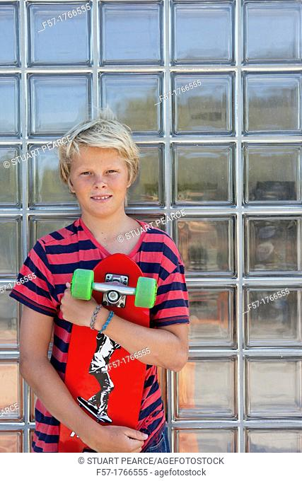 Teenage boy holding a long board