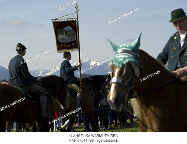 Performers in traditional costumes riding decorated horses for the traditional 'Georgiritts' on Easter Monday in Traunstein, Germany, 28 March 2016