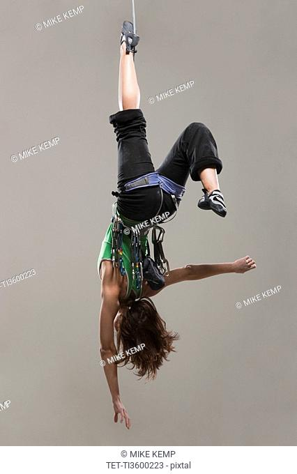 Female Climber hanging upside down
