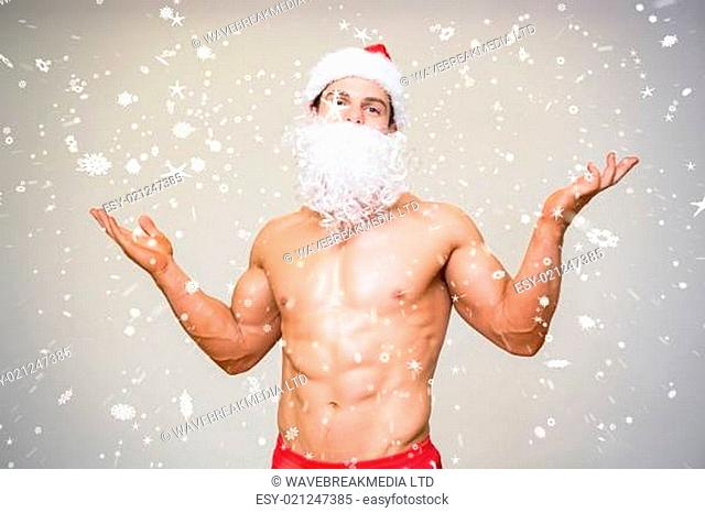 Portrait of shirtless macho man with fake santa beard