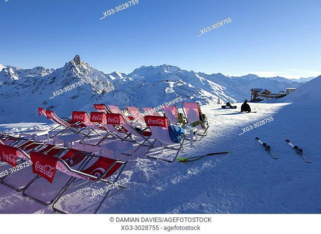 Mountain restuarant deck chairs, mountains and piste, Courchevel, Savoie, France
