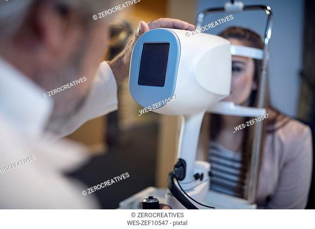 Young woman doing eye test at the optometrist's