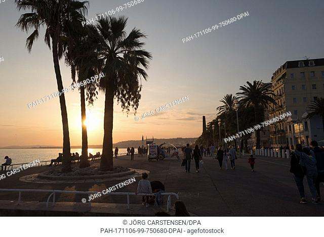 The sun sets over the beach promenade next to the Promenade des Anglais in Nice, France, 30 October 2017. The terrorist attack pn the 14th of July 2016 killed...