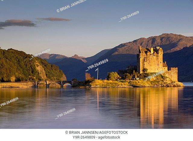 Setting sunlight on Eilean Donan Castle along Loch Duich, Dornie, Highlands, Scotland