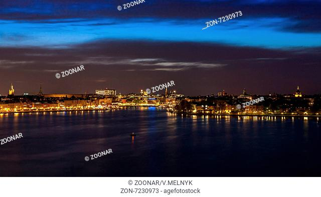 Stockholm at night with light reflection in water