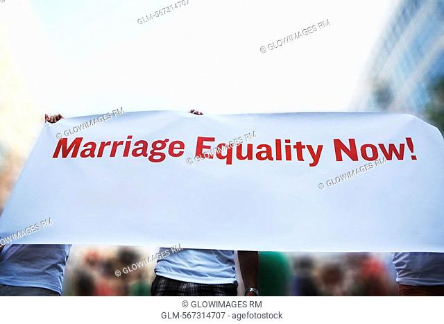 Three gay men holding a Marriage Equality banner, Washington DC, USA
