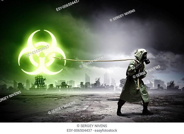 Man in respirator against nuclear background. Radioactivity concept