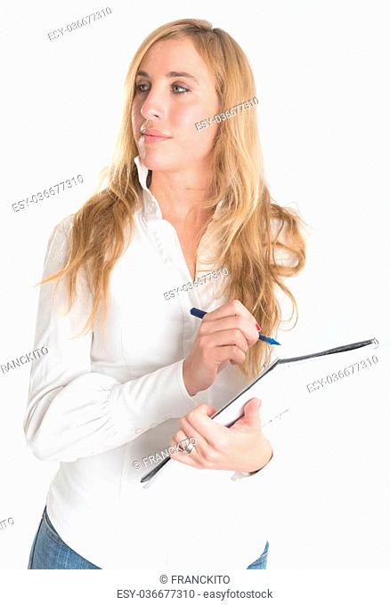Portrait of an attractive young blonde writing on a notebook