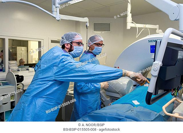 Reportage in the interventional scanner service in Pasteur 2 Hospital, Nice, France. Vertebroplasty- cementoplasty operation to treat a vertebral facture