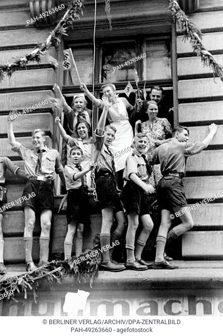 People cheer at Hitler's victory procession outside of the new Reichs Chancellery on Wilhelmplatz as Hitler returns from his Felsennest headquarters after the...