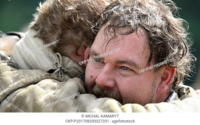 Residents of early medieval camp in historical costumes are seen in Brdecny near Neveklov, Czech Republic, August 20, 2017