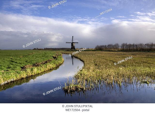Dutch polder landscape with a windmill in the region Alblasserwaard