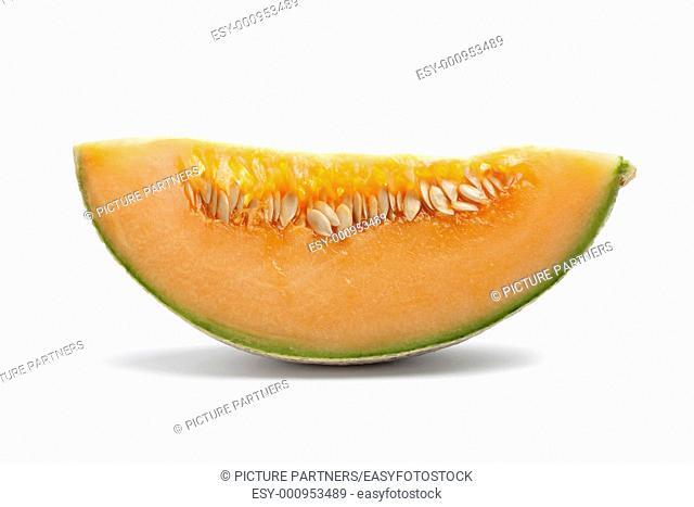 Slice of Cantaloupe melon isolated on white background