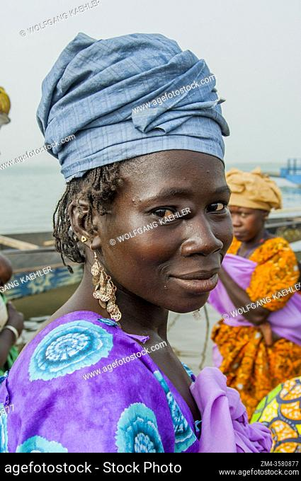 Portrait of a local woman standing on the bank of the Niger River in Segou, a city in the center of Mali, West Africa