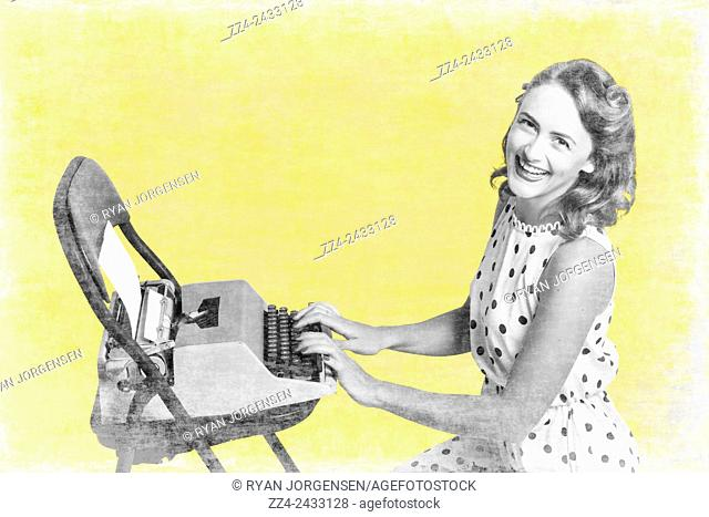 Retro yellow styled image of a beautiful old styled pin-up secretary laughing while writing notes and letters on old-fashion typewriter on vintage texture...