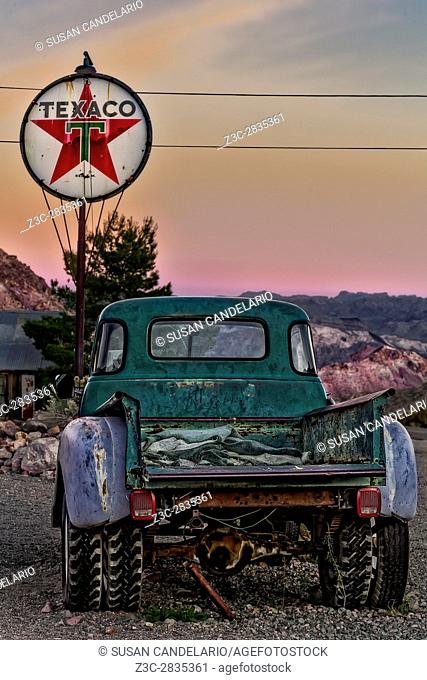 Texaco Gas Station - Vintage Texaco gas station with antique pick up truck during sunset