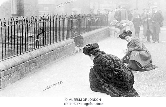 Emma Sproson (left) and a friend chalking the pavement, 1907. Suffragettes who went on 'chalking parties' had to be careful
