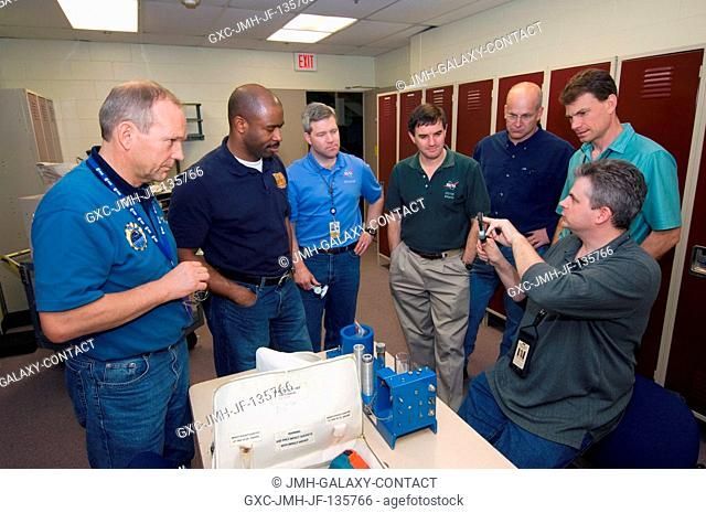 The STS-122 crewmembers participate in a tool training session in the Space Vehicle Mockup Facility at the Johnson Space Center