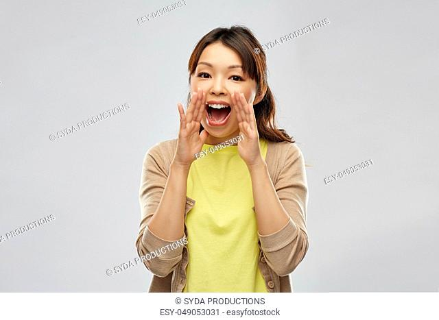 young asian woman calling for someone