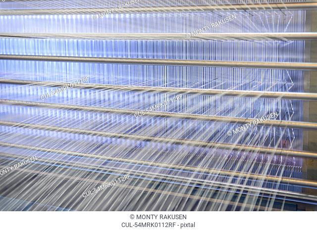 Threads on loom in textile mill