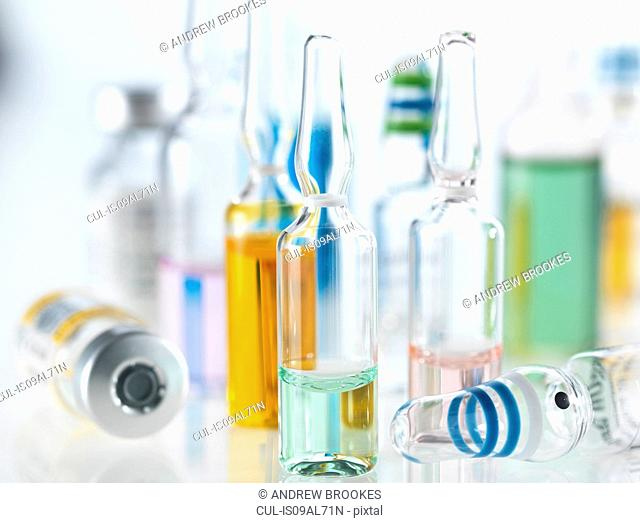 Variety of drugs including vials, ampules and vaccines illustrating medical research