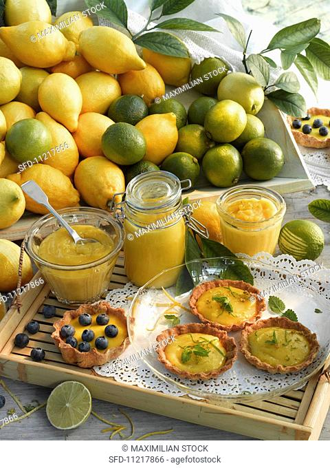 Lemon curd and lime curd in jars; tartlets with lemon curd and lime curd